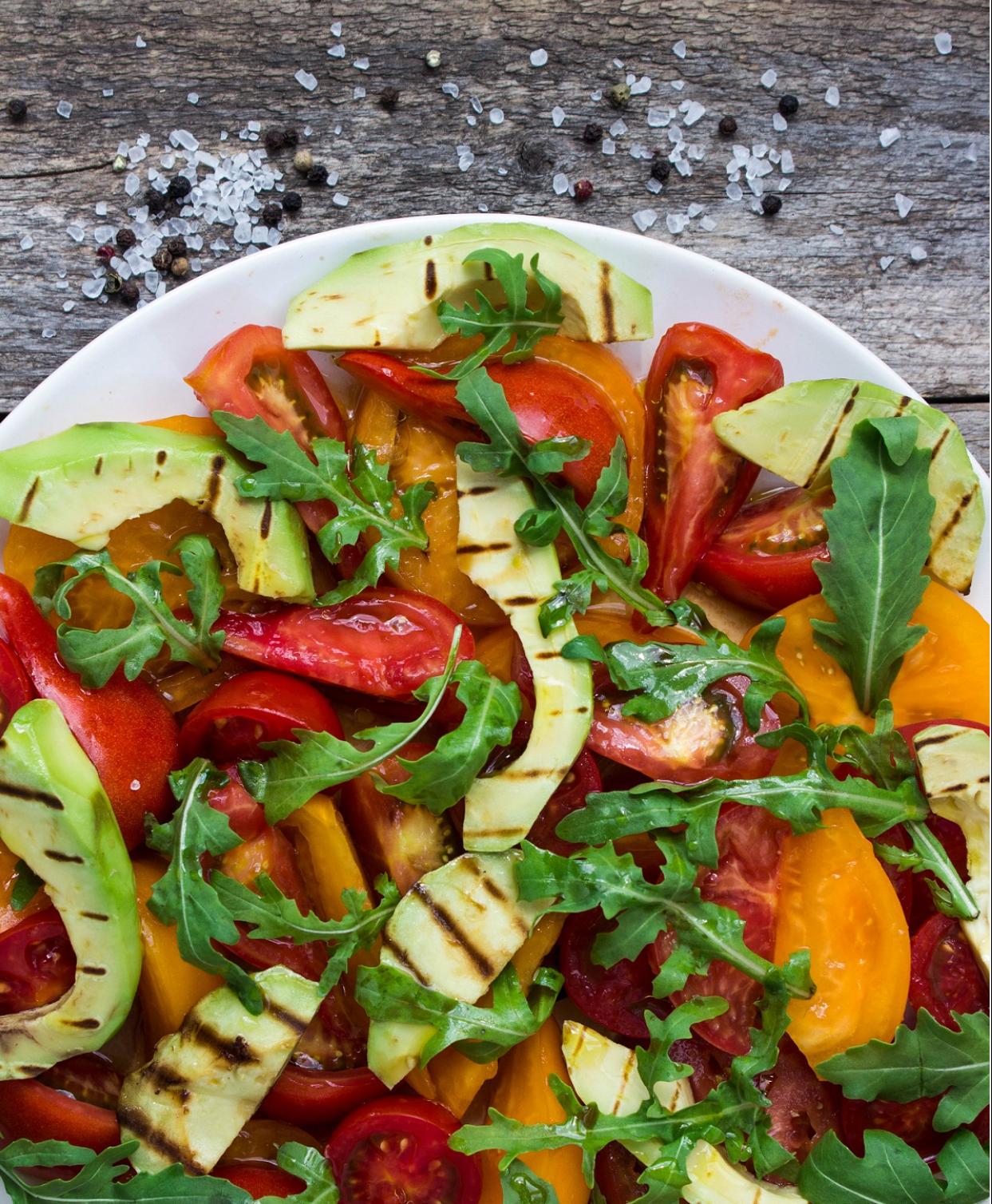 Arugula salad with roasted avocado and tomato